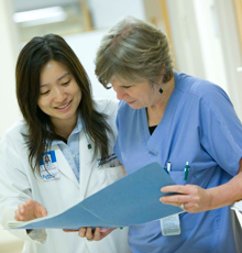 Hannah Lee, MD and a co-worker in gastroenterology reviewing a patient chart at Tufts Medical Center in Boston.