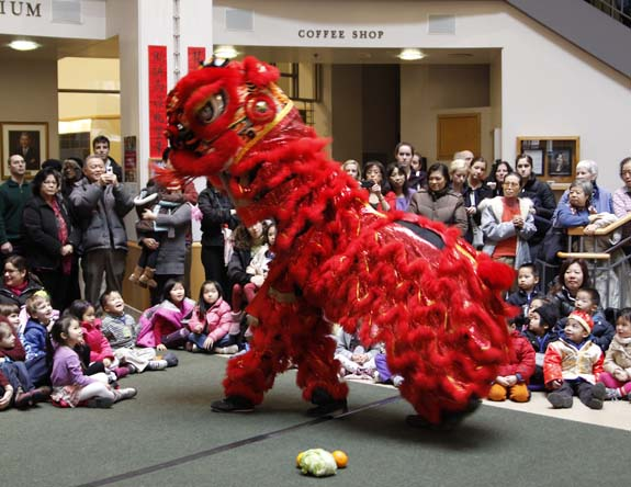 Red Chinese dragon ceremony with children watching at Tufts MC
